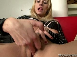 Rocco Siffredi watches this whore finger her snatch