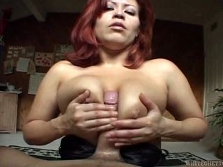 A guy with a fat cock gets stroked then ridden by a horny MILF