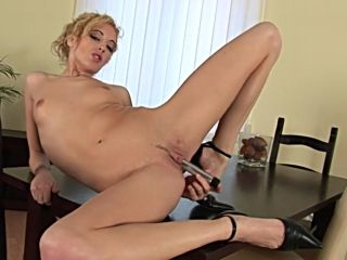 Short-Haired Skinny Blonde Poses Naked On The Table