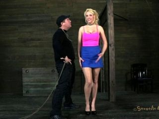 Blonde big tits getting fondled in BDSM torture shoot