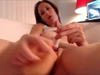 Enormous Orange Dildo Stuffed In The Warm Pink Pussy