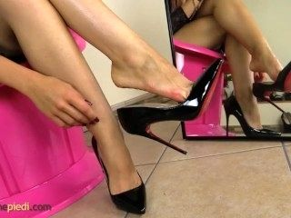 Sexy Redhead Puts Stiletto On Her Bare Feet (3)