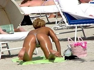 Split cola en Topless playa