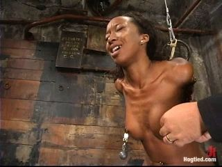 Slim Black girl gets tied up and humiliated in a dungeon