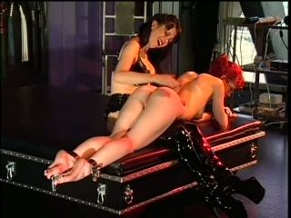 Dominant Justine Joli Smacks Her Lesbian Sex Slave's Ass With Her Hand