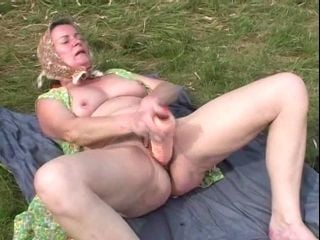 Masturbating Granny In The Grass Blows The Camera Guy (2)