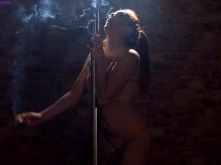 Kara Carter smoking strong corks while pole dancing
