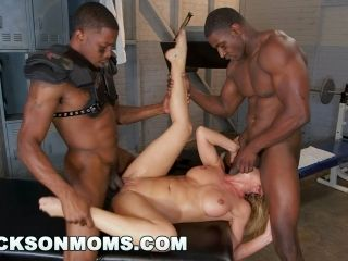 Blonde Bombshell Gets Hammered By Two Handsome Black Lads With Monster Cocks In The Gym
