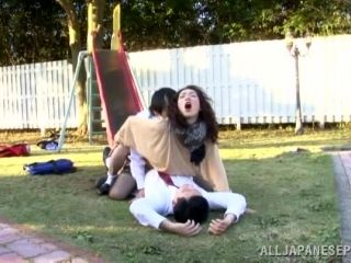 Horny Megumi Shino sucks one cock and rides another one outdoors