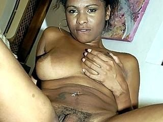 Latina Shemale Playing with her Boobs