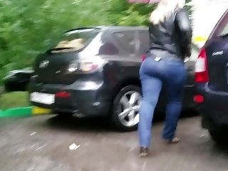 Two Blondes Asses In The Rain