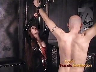 Slim Stunner Wearing Latex Has Some Dungeon Fun With A Bald