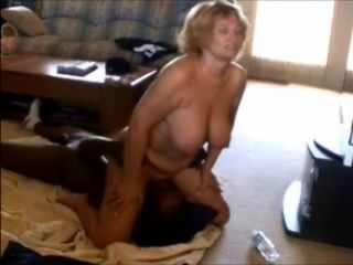 Mature forcing a BBC to lick her (2)