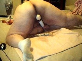 European fat granny fucks herself in a doggystyle position. Homemade video.