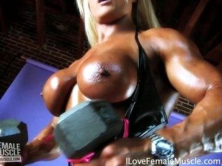 Huge Female Bodybuilder Lisa Cross Flexing Her Muscles