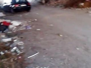 Whore Giorgetta hard assfisted in public among lots of waste