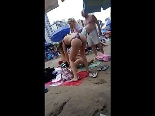 Young Skinny Girl With Thong On The Beach!