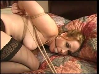 Julie Simone in stockings fastened on the couch for her masters enjoyment (2)