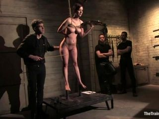 Bondage Scene With A Submissive Redhead And Her Masters