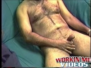 Hairy mature amateur Shawn solo plays with his cock on a bed (3)