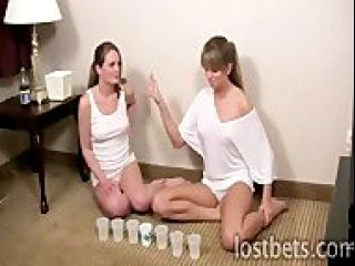Both girls are clad in nothing but thin Tshirts and panties. Each time they lose a throw, they get a cup of water poured on them....first the back of the panties, then the front of the panties, then two to the chest. A fifth loss costs them the game, and