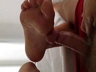 My Wife's Holiday Footjob With Massive Cumshot