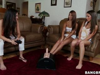 Eli, Lizz Tayler and Trinity St. Clair test their new toys in the living room