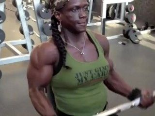 Ebony Muscle Woman Pumping Up Her Biceps