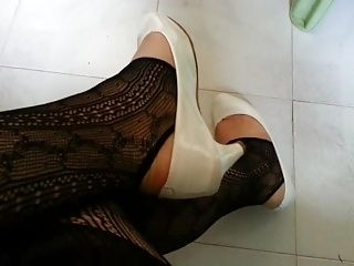 White Patent Pumps with Black Stirrup Tights Teaser
