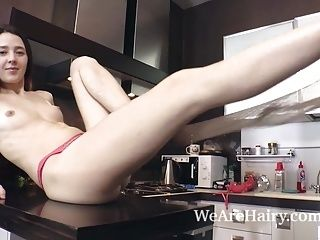 Lisa Carry strips naked and plays in her kitchen (2)