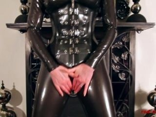 Red Lubes Up Her Latex Catsuit And Rubs Her Juicy Wet Pussy (5)