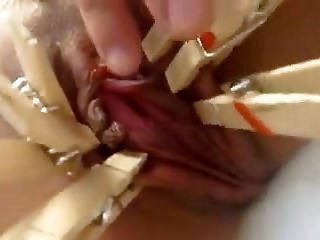 Close Up Kinky Action With Clothes Pins And A Shaved Pussy (2)