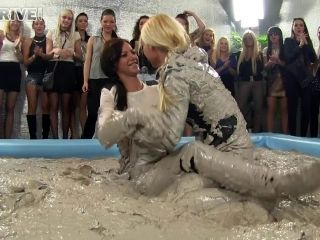 Vanessa and Nathaly Cherie wrestling in a pile of mud