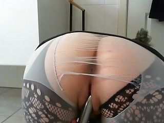 Girl With Nice Ass Plays With Herself Using A Vibrator