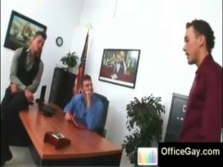 3 gay studs in suits at the office kissing