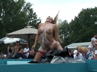 Sexy Bosomy Blonde Stipteases In Public During An Outdoor Party