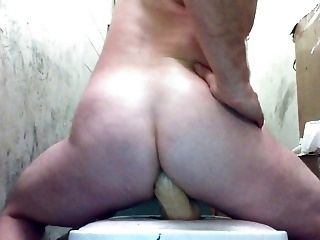 Joey D round shaved ass opening wide for dildo