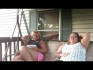 Two Big Girls sits on a Front Porch Swing Farting