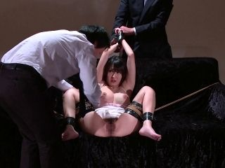 Bondage slave yelling when worked on with toy in BDSM