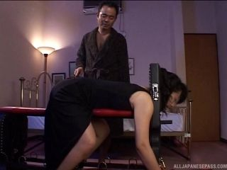 Submissive Asian MILF tied down and has her big ass covered in hot wax
