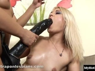 Blonde With A Gigantic Strap-On Penetrates Her Lesbian Friend With It (2)
