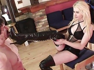Young blonde Girl spitting and man boot licking