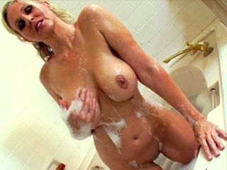 Sensual blonde with shaved pussy Julia Ann is touching her vag