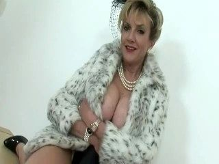 LADY SONIA models and blows the photographer