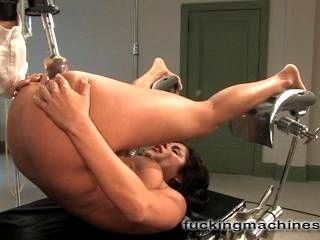 Michele is having trouble getting off so she makes an appointment at The Fuckingmachines sex clinic for help with her orgasms. First she spreads wide in the stirrups while The Little Guy vibes her clit, warming her up before driving deep into her pussy un
