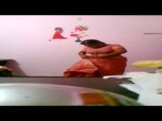 Mature Aunty Orange Saree & Blouse Removal Recorded in Hidden Cam