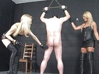 Two blonde Mistresses whipping male slave