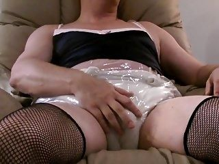 Sissy Crossdresser In Fishnets Diaper  Flooding