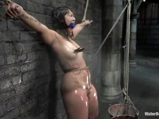 Gagged Asian is tied with ropes and her clamped tits jet sprayed with water
