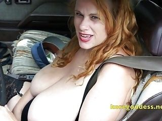 Big Tits Woman Masturbates As She Drives
